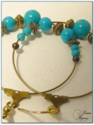boucle d'oreille fantaisie créole 40 mm finition bronze perles verre turquoise