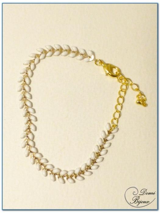 bracelet fantaisie finition doré motif epis émail blanc
