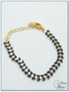 bracelet fantaisie finition doré motif épis émaillé noir